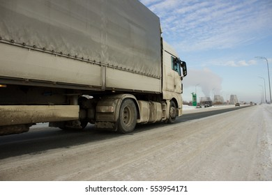 The truck on road. Container on the big winter highway. transport loads.
