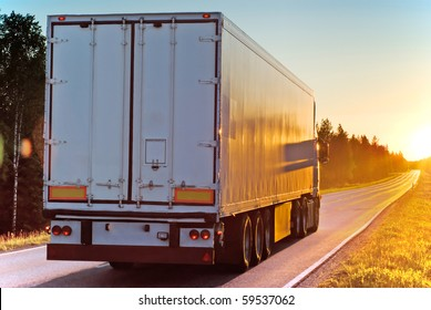 Truck on a road in the evening