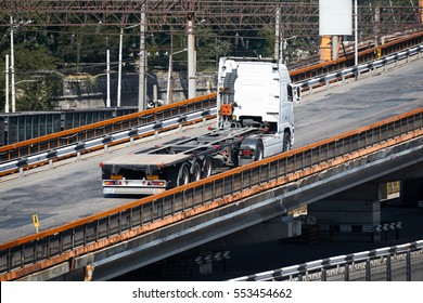 truck on road, rides up over the bridge, industrial infrastructure, cargo transportation, delivery and shipping concept