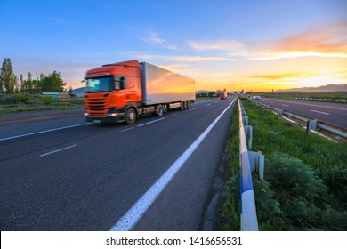 truck on road at the sunset