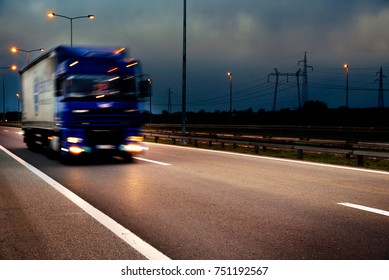 Truck on the road, the vehicle on the move is blur