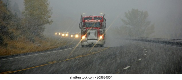 Truck and other vehicles moving through fog and snowstorm,Rocky Mountains,Idaho