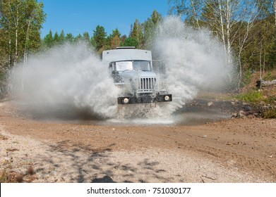 the truck passes through a puddle
