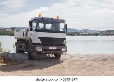 truck pours the sea rocks