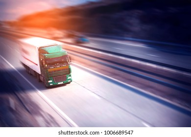 truck in road at sunset