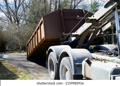 Truck roll-off dumpster