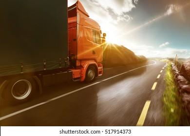 Truck rolls through a sunny landscape