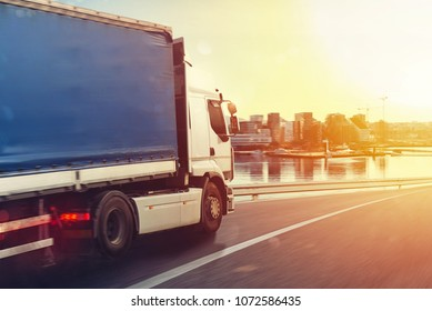 Truck run fast on the highway to deliver
