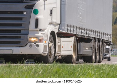 Truck with semi-trailer driving in the spring in freight traffic