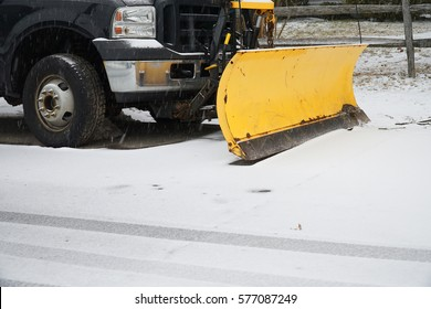 truck with snowplow installed in the residential street