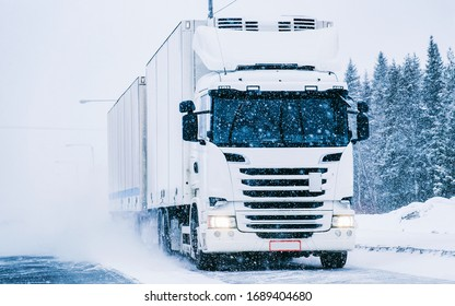 Truck at the Snowy winter Road at Finland in Lapland.