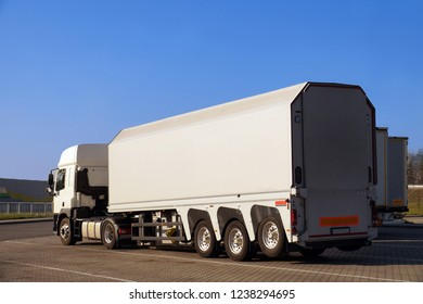 A truck with a specialist trailer for the transport of concrete slabs and glass.