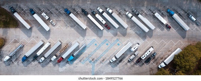 Truck stop on Rest area On the highway. Top view car parking lot. Truck Driver company. View from the bird's flight. Aerial photography. Copy space.