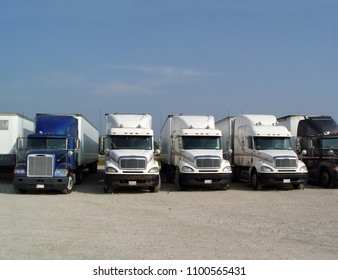 Truck stop, resting place, a row of trucks parked