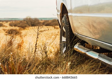 Truck stopped in a dry field