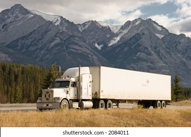a truck stops in a rest area in the Canadian Rockies
