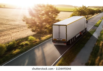 Truck at sunrise on a country road