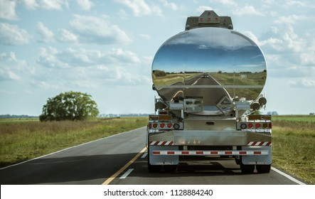 A truck tank of gasoline with reflection on the road