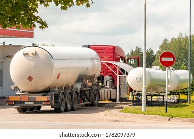 Truck with a tank for propane or other fuel. Unloading at a gas station