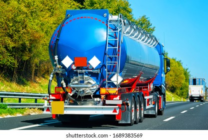 Truck tanker on the road in Italy. Lorry transport delivering some freight cargo.