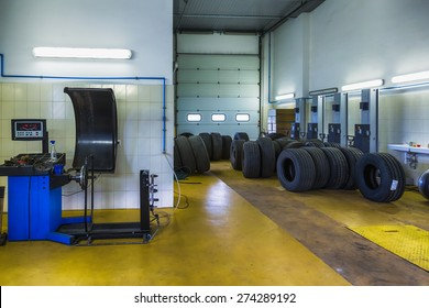 Truck tires or tyres repair shop service interior with wheel balancer