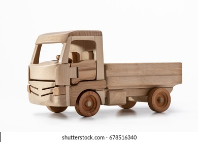 The truck is a toy made of natural wood.