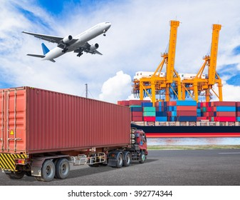 Truck transport container and cargo plane flying above ship port with working crane loading bridge in shipyard for logistic import export concept