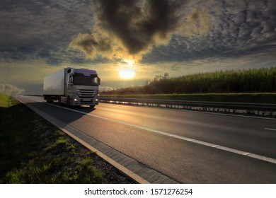Truck transport on the road at sunset and cargo