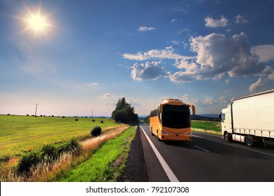 Truck transportation and bus on the road at sunset