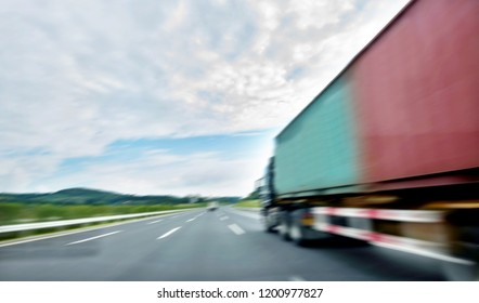 Truck transportation on high road, motion blur