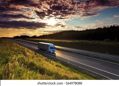Truck transportation at sunset