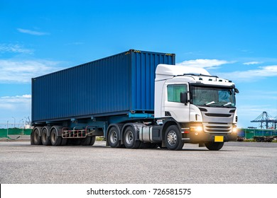 Truck transportation,import,export logistic industrial with beautiful sky and shipyard background,Thailand