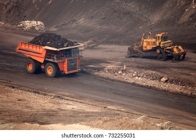 The truck transporting coal.