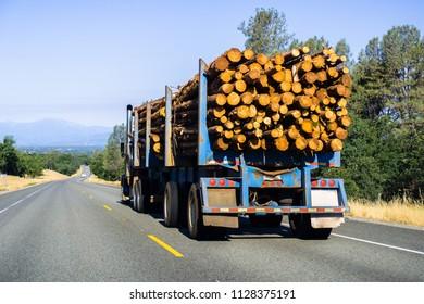 Truck transporting logs near Redding, California