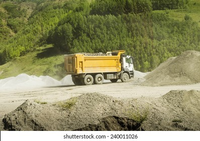 Truck transports soil on the sand at Construction Site