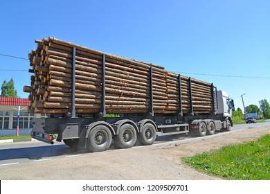 The truck transports wood down the street. Poshekhonje, Yaroslavl region