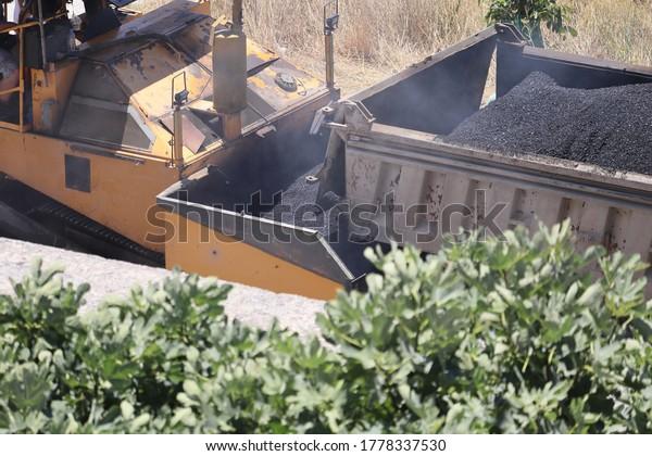 truck-unloading-asphalt-tar-paving-600w-