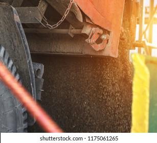 The truck unloads grain at the grain storage and processing plant, corn, trailer, unload corn, close up