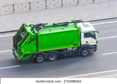 Truck for waste collection in residential areas of the city rides on the road