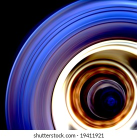 Truck wheel captured on highway with motion blur. Very dynamic image and unusual view.