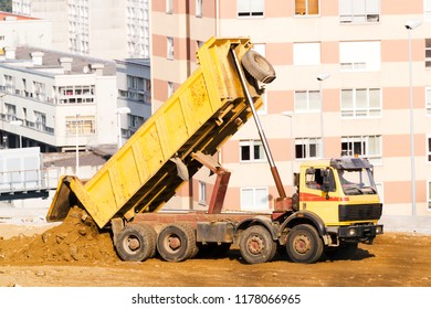 truck  working in site for buildings construction in city