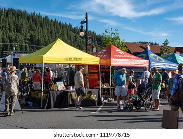 "TRUCKEE, CA/U.S.A. - JUNE 14, 2016: A photo of visitors and various vendors at ""Truckee Thursdays,"" a weekly summer event that includes entertainment, merchandise and food vendors."
