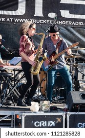 """TRUCKEE, CA/U.S.A. - JUNE 14, 2016: Nancy Wright and Mike Schermer play together at a free concert at """"Truckee Thursdays,"""" a weekly event that includes entertainment, merchandise and food vendors."""