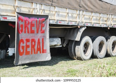 "Trucker on strike. Side of a truck with a message written ""Greve Geral"" (on strike written in portuguese)."