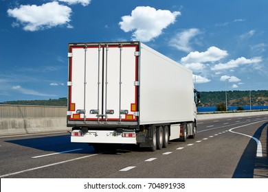 Trucks with cargo on highway, shipping and transportation concept