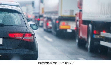Trucks and cars on highway in traffic jam