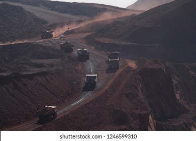 Trucks compare with car in ore daylight mining in africa