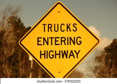 TRUCKS ENTERING HIGHWAY SIGN