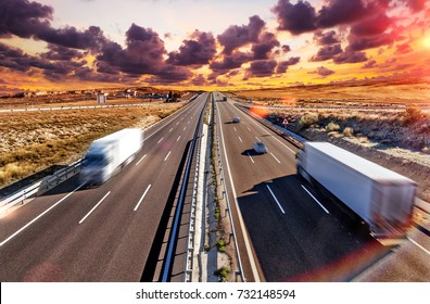 Trucks and highway. International forwarding. Lorries carrying goods and highway