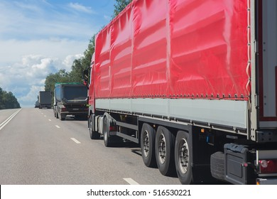 trucks move on on highway in country